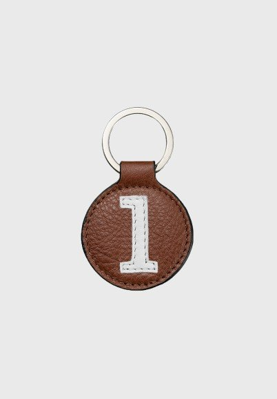 Brown and white leather key...